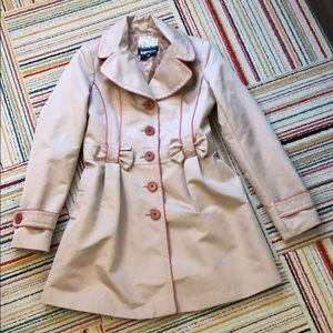 Tan spring jacket with salmon colored piping